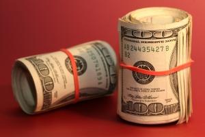 100 hundred dollar bills rolled
